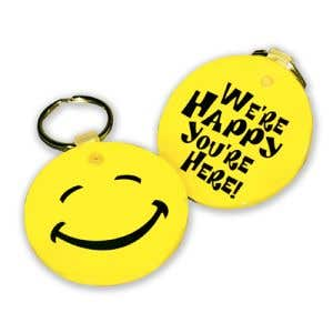 """Vinyl Key Tag - """"We're Happy You're Here"""" Smiley Face"""