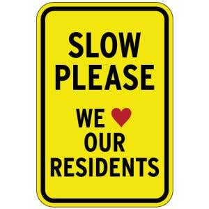 Slow We love Our Residents Aluminum Sign